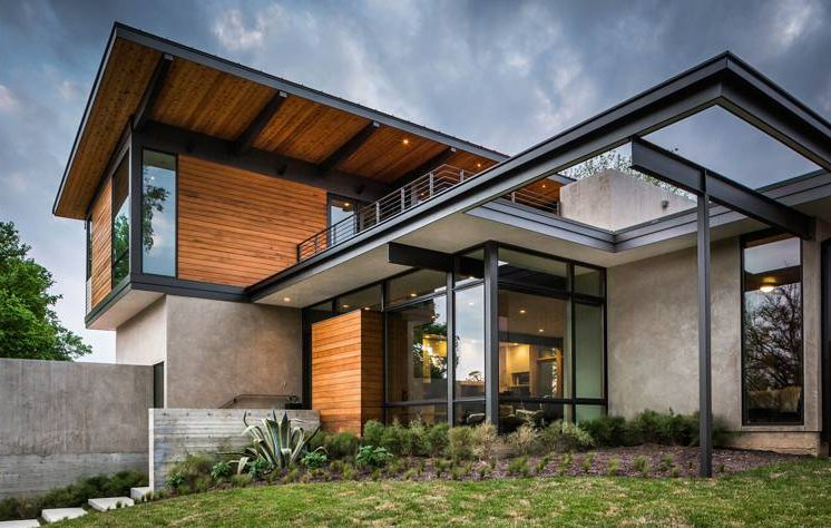 Fachada de casa moderna con materiales ligeros y esbeltos.